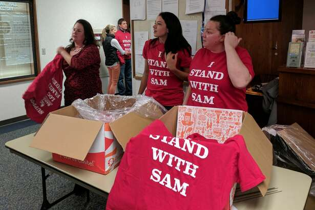 (Right to left) Amy Palmer, Lauren Bridge and Jena Palmer distributed shirts at Greenwich Planning and Zoning Tuesday evening in support of Sam Bridge Nursery and Greenhouse. Their amendment to municipal code was approved without additional measures to reduce noise.