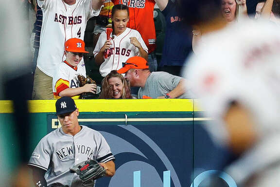"Amanda Riley believes the home run ball nearly caught by son Carson, left, was a sign. ""Just the way the ball touched each one of us,"" she said, recalling how her late son, Cade, was a big fan of the player who was unable to stop it from reaching the stands, the Yankees' Aaron Judge."