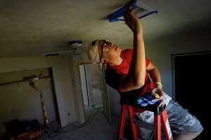 Jon Chan, a paralegal with Dow, helps repair flood-damaged houses along with other volunteers, in Houston.