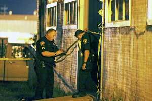 Police investigate the scene near where two children are injured in a shooting in an appartment complex at 3735 E. Commerce on October 17, 2017.