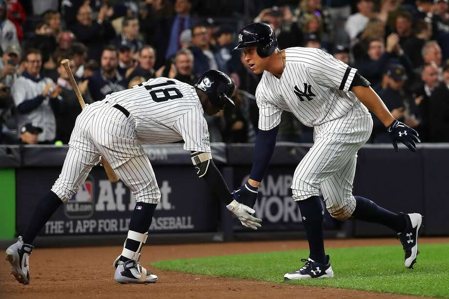 The Yankees' Aaron Judge celebrates his solo home run with shortstop Didi Gregorius (18) in the seventh inning. Photo: CHANG W. LEE, NYT