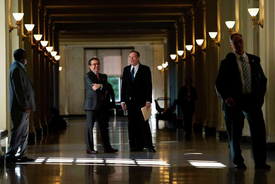 Mexican Secretary of Economy Ildefonso Guajardo Villarreal, left, and U.S. Trade Representative Robert Lighthizer wait for the start of a news conference after the fourth round of NAFTA negotiations in Washington. Photo: ANDREW CABALLERO-REYNOLDS, Contributor / AFP or licensors