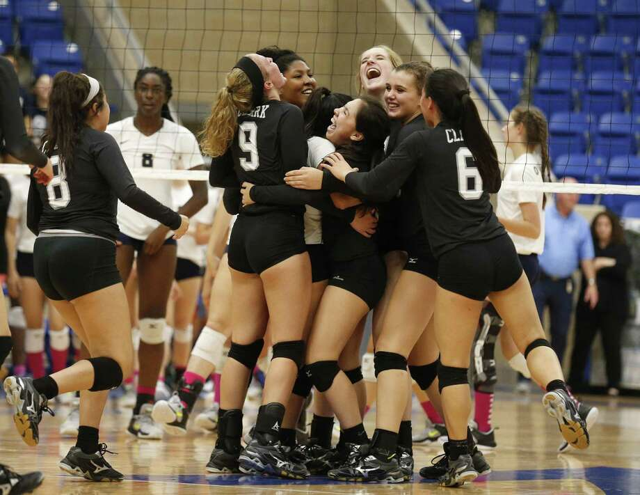The Clark volleyball team celebrates after defeating O'Connor during at Northside ISD Gym on Tuesday, Oct. 17, 2017. Clark defeated O'Connor, 3-2, to take the night's win and both teams are now tied for first in District 28-6A. (Kin Man Hui/San Antonio Express-News) Photo: Kin Man Hui, Staff / San Antonio Express-News / ©2017 San Antonio Express-News
