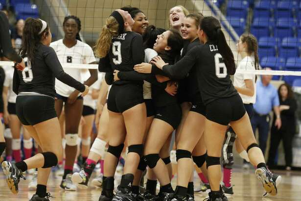 The Clark volleyball team celebrates after defeating O'Connor during at Northside ISD Gym on Tuesday, Oct. 17, 2017. Clark defeated O'Connor, 3-2, to take the night's win and both teams are now tied for first in District 28-6A. (Kin Man Hui/San Antonio Express-News)
