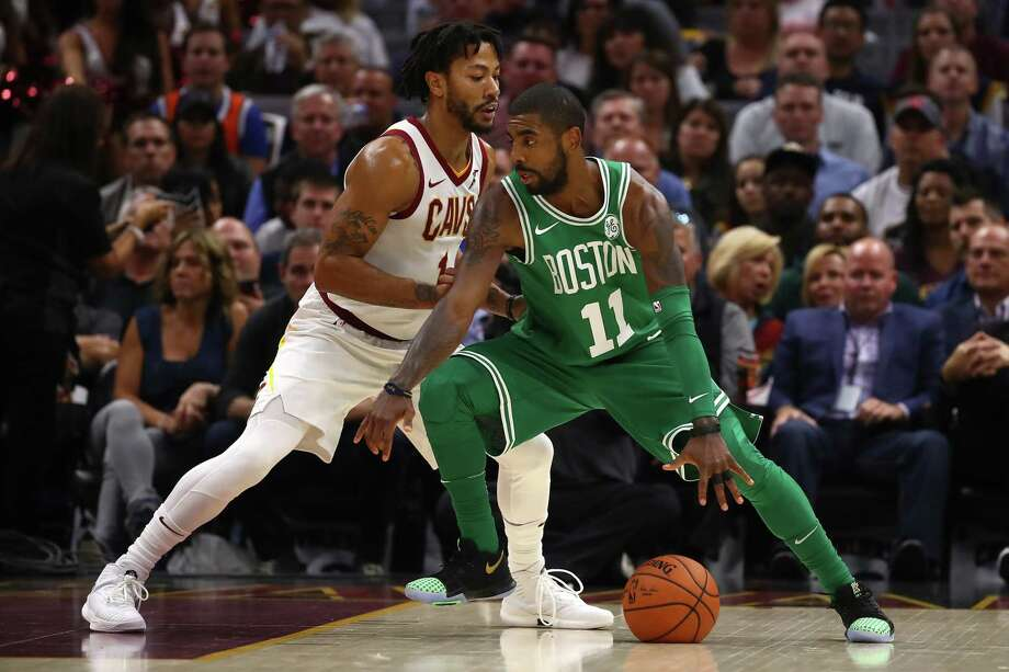 CLEVELAND, OH - OCTOBER 17:  Kyrie Irving #11 of the Boston Celtics tries to get around Derrick Rose #1 of the Cleveland Cavaliers during the first half at Quicken Loans Arena on October 17, 2017 in Cleveland, Ohio. NOTE TO USER: User expressly acknowledges and agrees that, by downloading and or using this photograph, User is consenting to the terms and conditions of the Getty Images License Agreement.  (Photo by Gregory Shamus/Getty Images) Photo: Gregory Shamus / 2017 Getty Images