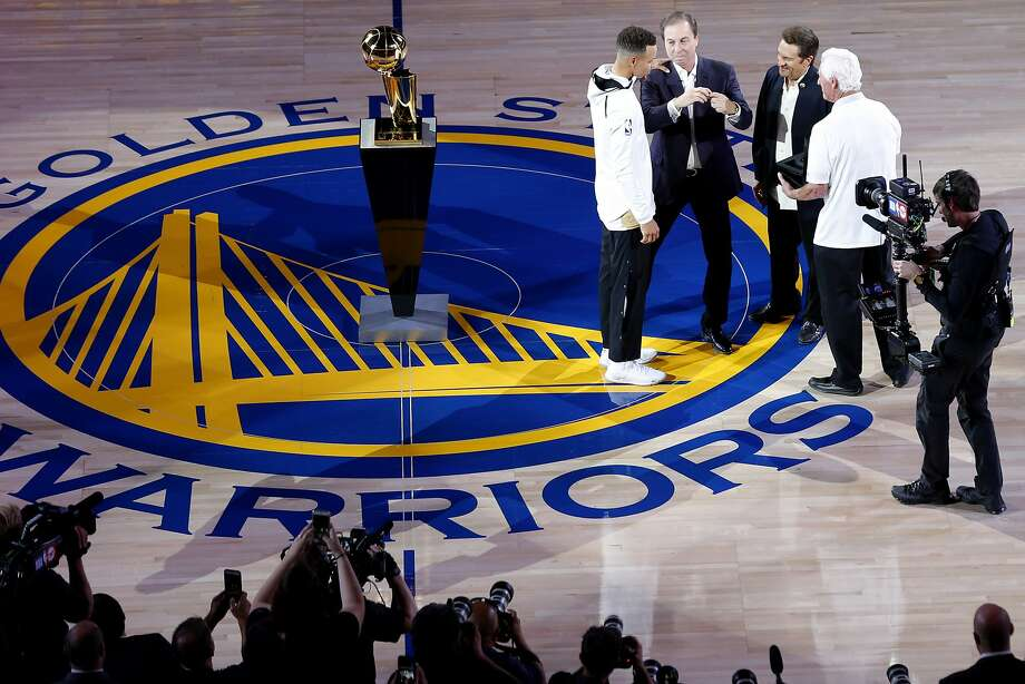 CEO Larry Baer, right, and the rest of the Giants' ownership are at a crossroads and, at No. 2 in our rankings, will have to try harder to match the stewardship of Warriors owners Joe Lacob and Peter Guber, presenting Stephen Curry, above, with his second championship ring in three seasons. Photo: Santiago Mejia, The Chronicle