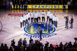 The Golden State Warriors are on the court with NBA Commissioner Adam Silver for the Warriors' ring ceremony before an NBA game between the Warriors and the Houston Rockets at Oracle Arena on Tuesday, Oct. 17, 2017, in Oakland, Calif.
