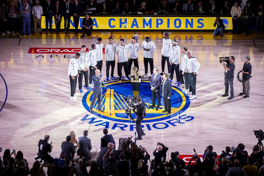 The Golden State Warriors are on the court with NBA Commissioner Adam Silver for the Warriors' ring ceremony before an NBA game between the Warriors and the Houston Rockets at Oracle Arena on Tuesday, Oct. 17, 2017, in Oakland, Calif. Photo: Santiago Mejia, The Chronicle