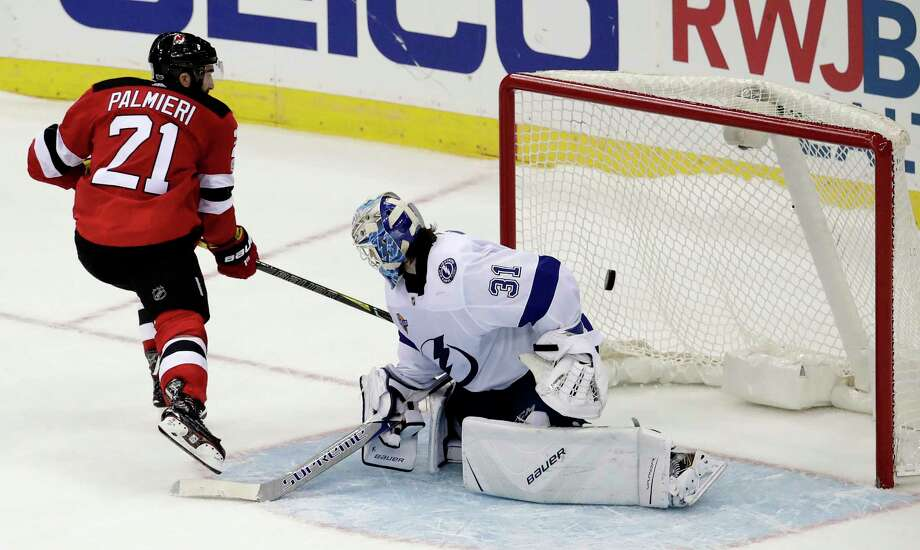 New Jersey Devils right wing Kyle Palmieri (21) scores a goal against Tampa Bay Lightning goalie Peter Budaj, of Slovakia, (31) during a shootout in an NHL hockey game, Tuesday, Oct. 17, 2017, in Newark, N.J. The Devils won 5-4 in a shootout. (AP Photo/Julio Cortez) ORG XMIT: NJJC111 Photo: Julio Cortez / Copyright 2017 The Associated Press. All rights reserved.