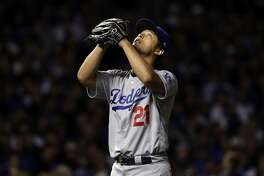 Los Angeles Dodgers starting pitcher Yu Darvish (21) looks up the sky as he leaves during the seventh inning of Game 3 of baseball's National League Championship Series against the Chicago Cubs, Tuesday, Oct. 17, 2017, in Chicago. (AP Photo/Matt Slocum)