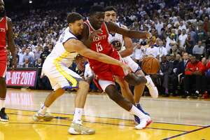 OAKLAND, CA - OCTOBER 17:  Klay Thompson #11 of the Golden State Warriors defends Clint Capela #15 of the Houston Rockets during their NBA game at ORACLE Arena on October 17, 2017 in Oakland, California. NOTE TO USER: User expressly acknowledges and agrees that, by downloading and or using this photograph, User is consenting to the terms and conditions of the Getty Images License Agreement.  (Photo by Ezra Shaw/Getty Images)