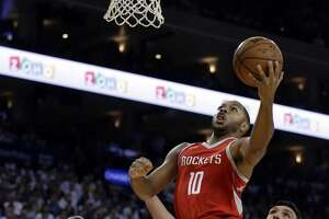 Houston Rockets' Eric Gordon (10) lays up a shot over Golden State Warriors' Zaza Pachulia during the first quarter of an NBA basketball game Tuesday, Oct. 17, 2017, in Oakland, Calif. (AP Photo/Ben Margot)