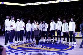 The Warriors ready for the presentation of the rings before the first half as the Golden State Warriors played the Houston Rockets at Oracle Arena in Oakland, Calif., Tuesday, October 17, 2017.