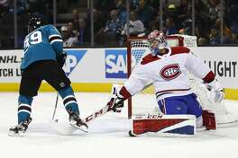 Montreal Canadiens goalie Carey Price (31) looks back as San Jose Sharks center Logan Couture (39) scores a goal during the first period of an NHL hockey game, Tuesday, Oct. 17, 2017, in San Jose, Calif. (AP Photo/Tony Avelar)