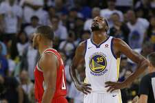 Golden State Warriors forward Kevin Durant (35) and Houston Rockets guard Eric Gordon (10) during the third quarter of an NBA game between the Golden State Warriors and the Houston Rockets at Oracle Arena on Tuesday, Oct. 17, 2017, in Oakland, Calif. The Warriors lost the basketball game 122-121.