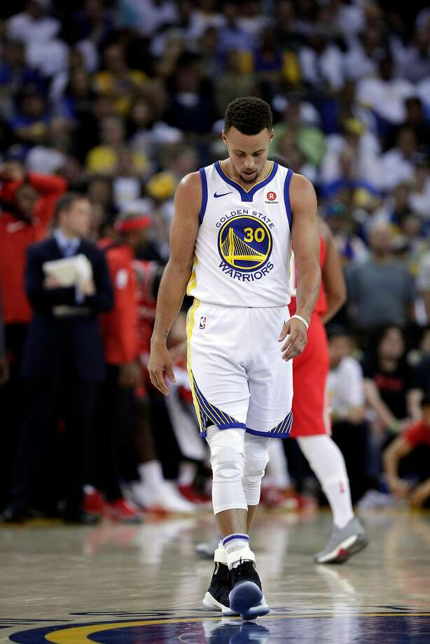 Stephen Curry (30) walks back up court after a call went against the Warriors in the second half as the Golden State Warriors played the Houston Rockets at Oracle Arena in Oakland, Calif., Tuesday, October 17, 2017. The Warriors lost 122-121. Photo: Carlos Avila Gonzalez, The Chronicle