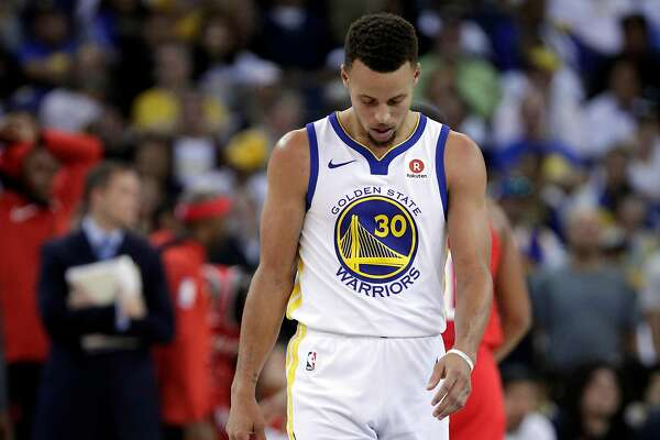Stephen Curry (30) walks back up court after a call went against the Warriors in the second half as the Golden State Warriors played the Houston Rockets at Oracle Arena in Oakland, Calif., Tuesday, October 17, 2017. The Warriors lost 122-121.