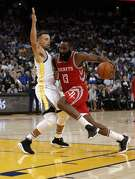 Stephen Curry (30) guards against James Harden (13) in the second half as the Golden State Warriors played the Houston Rockets at Oracle Arena in Oakland, Calif., Tuesday, October 17, 2017.