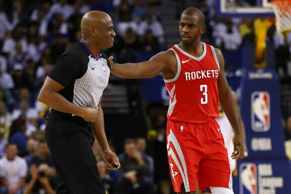 OAKLAND, CA - OCTOBER 17:  Chris Paul #3 of the Houston Rockets checks on referee Tre Maddox #73 after he fell during their NBA game against the Golden State Warriors at ORACLE Arena on October 17, 2017 in Oakland, California. NOTE TO USER: User expressly acknowledges and agrees that, by downloading and or using this photograph, User is consenting to the terms and conditions of the Getty Images License Agreement.  (Photo by Ezra Shaw/Getty Images)