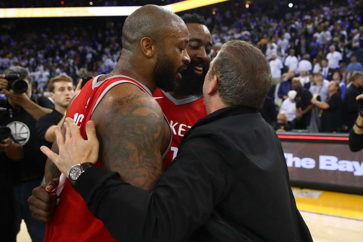 OAKLAND, CA - OCTOBER 17: PJ Tucker #4, James Harden #13 and team owner Tilman Fertitta of the Houston Rockets celebrate after defeating the Golden State Warriors 122-121 in their NBA game at ORACLE Arena on October 17, 2017 in Oakland, California. NOTE TO USER: User expressly acknowledges and agrees that, by downloading and or using this photograph, User is consenting to the terms and conditions of the Getty Images License Agreement. (Photo by Ezra Shaw/Getty Images)