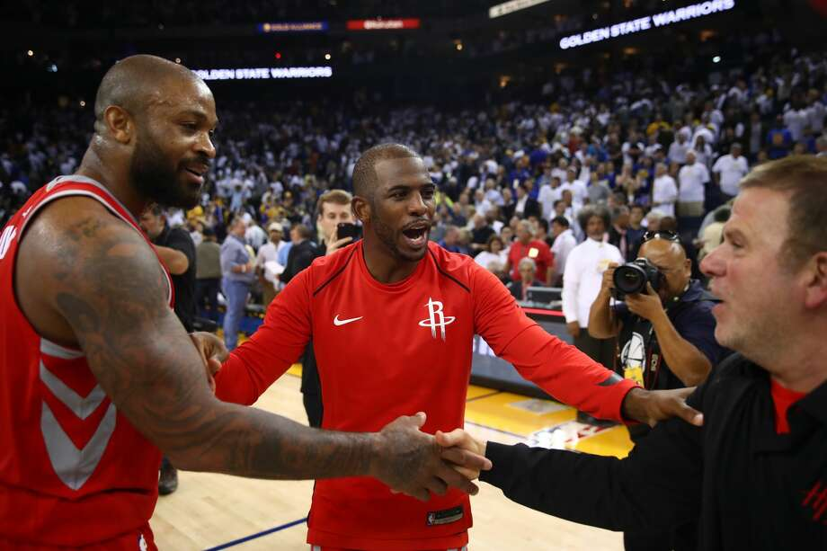 OAKLAND, CA - OCTOBER 17:  PJ Tucker #4, Chris Paul #3 and team owner Tilman Fertitta of the Houston Rockets celebrate after defeating the Golden State Warriors 122-121 in their NBA game at ORACLE Arena on October 17, 2017 in Oakland, California. NOTE TO USER: User expressly acknowledges and agrees that, by downloading and or using this photograph, User is consenting to the terms and conditions of the Getty Images License Agreement.  (Photo by Ezra Shaw/Getty Images) Photo: Ezra Shaw/Getty Images