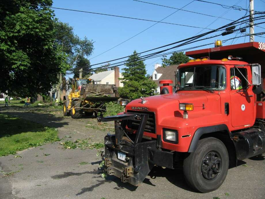 Stratford DPW crews clean up Stratford Road in the town's Lordship section, the town's hardest-hit neighborhood. Photo: John Burgeson, Autumn Driscoll / Connecticut Post