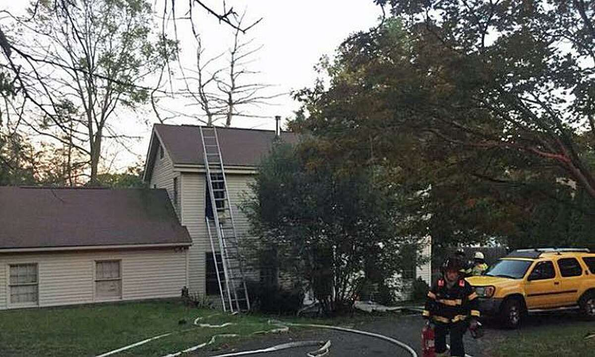 Residents of a Stadley Rough Road house in Danbury were displaced Tuesday after a fire swept through their home on Tuesday, Oct. 17, 2017.