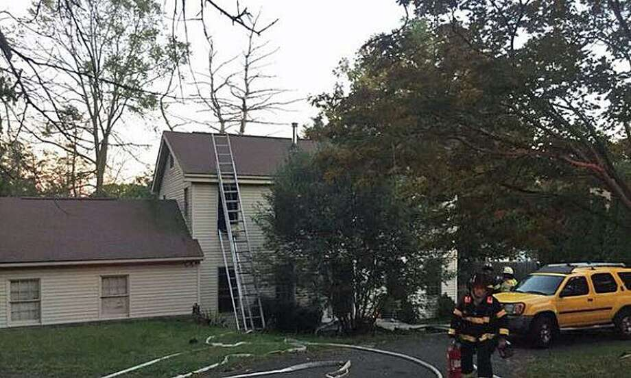 Residents of a Stadley Rough Road house in Danbury were displaced Tuesday after a fire swept through their home on Tuesday, Oct. 17, 2017. Photo: Danbury Fire Department Photo