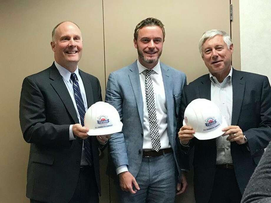 Ben Taylor, center, of the U.S. Chamber of Commerce, presentsU.S. Reps. John Moolenaar, left, and Fred Upton with theSpirit of Enterprise Awardduring aMidland Area Chamber of CommerceGovernment Issues Committee meeting on Monday. (Photo provided)