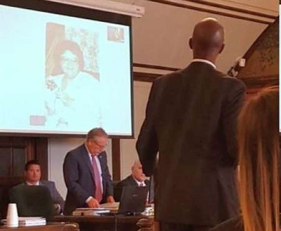 A photo of homicide victim Diane Ross is shown to the jury as the first exhibit in the cold case homicide trial of Michael McIntyre, 52, New Hudson, on Tuesday morning. McIntyre faces counts of first-degree premeditated murder and felony murder in connection with the 1991 killing. (kdame/kdame@mdn.net)