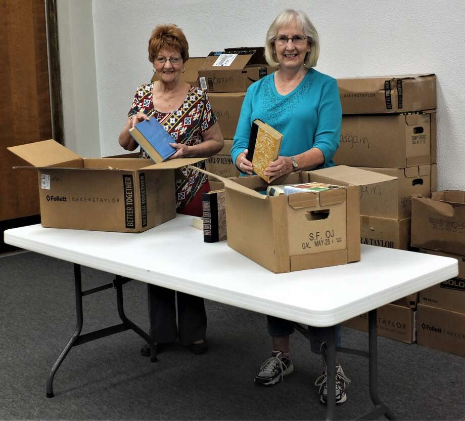 Ophelia Burns and Barbara DeBerry prepare for the upcoming Fall Book Sale sponsored by the Friends of the Unger Memorial Library. The sale will be Saturday, Oct. 21, from 9 a.m. to 4 p.m. Admission is free. Hardcover fiction books are 50 cents each, paperbacks 25 cents each, and new this year are bargain books for 10 cents each or a box (provided by the Friends) filled with bargain books for $3. There is a large selection of books from which to choose. The sale is housed in the basement of Unger Memorial Library, 825 N. Austin St.
