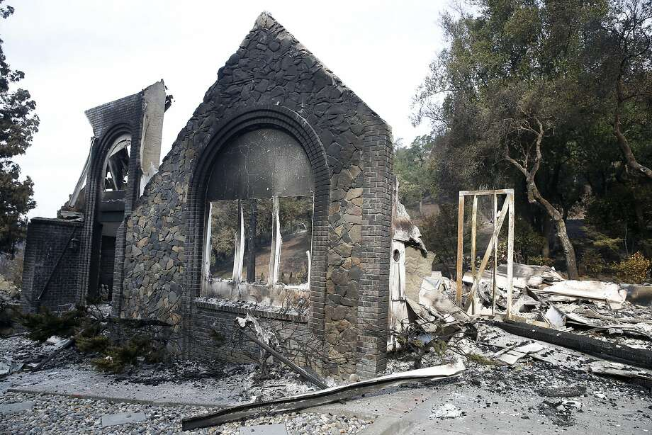 A stone facade of a home on Parker Hill Road still stands in the Fountaingrove neighborhood of Santa Rosa, Calif. on Tuesday Oct. 17, 2017 after the Tubbs Fire roared through the neighborhood last week. Photo: Paul Chinn, The Chronicle