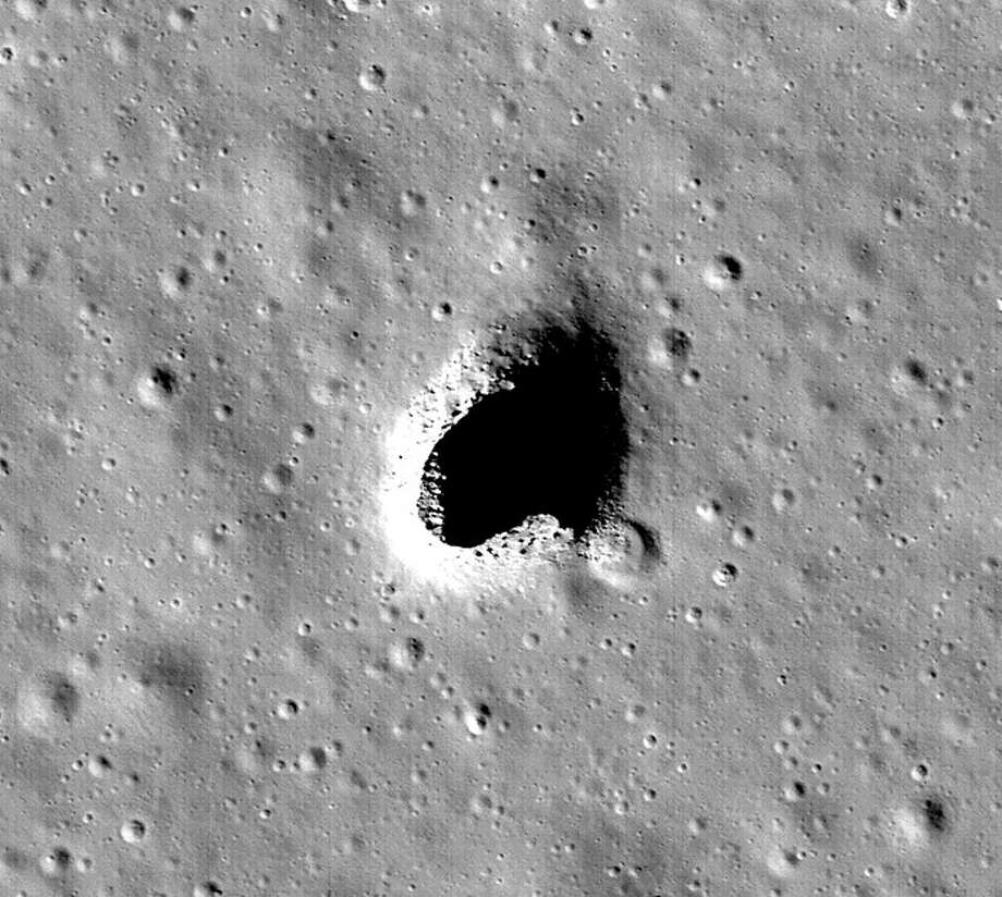 Researchers have found a large open lava tube on the moon, which could be a location for building a human base. The opening pictured here has been dubbed the Marius Hills Skylight.See strange things that have been spotted in NASA photos up ahead. Photo: NASA / Goddard / Arizona State University
