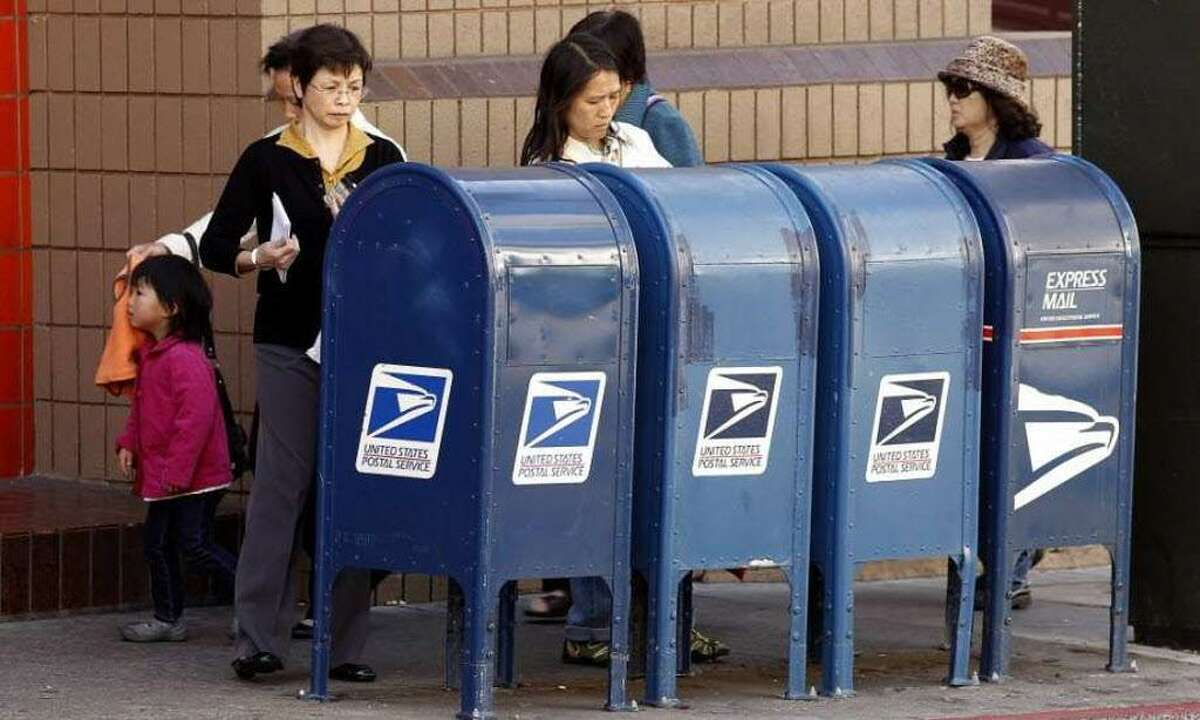 People post their letters for the U.S. Postal Service to deliver.