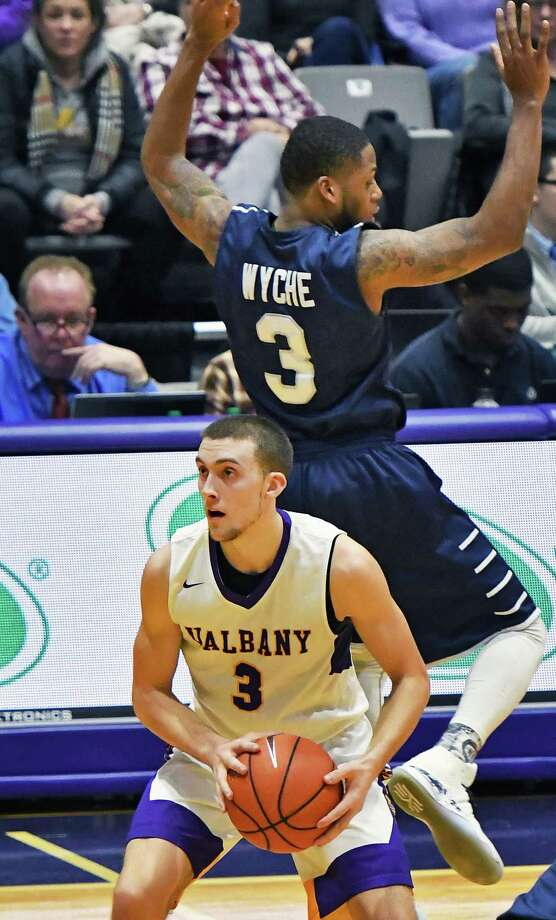 UAlbany's #3 Joe Cremo, left, fakes out Saint Peter's defender #3 Trevis Wyche before getting a shot off during their CIT Tournament game Thursday March 16, 2017 in Albany, NY.  (John Carl D'Annibale / Times Union) ORG XMIT: MER2017031621395170 Photo: John Carl D'Annibale / 20039961A