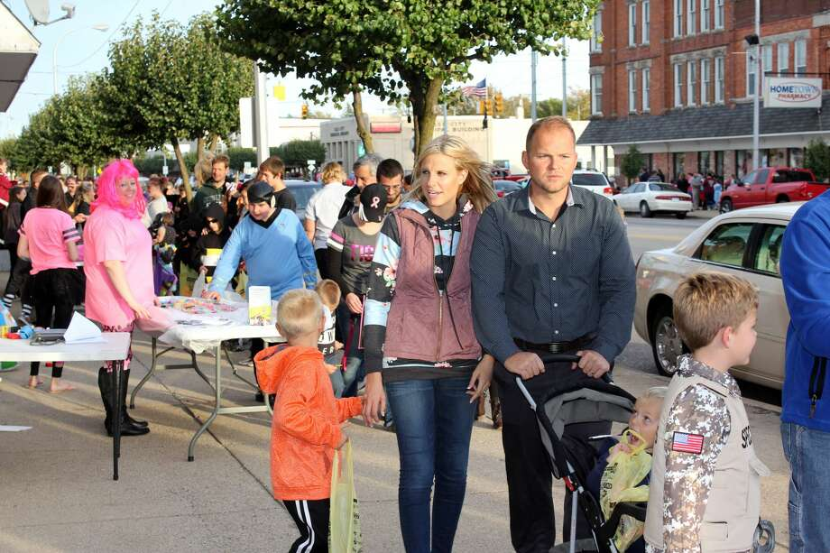 Hundreds flooded the sidewalks of Cass City Tuesday for this year's Pink or Treat. Businesses up and down Main Street handed out treats to top off the town's month-long celebration of Pinktober for breast cancer awareness. Photo: Brenda Battel/Huron Daily Tribune