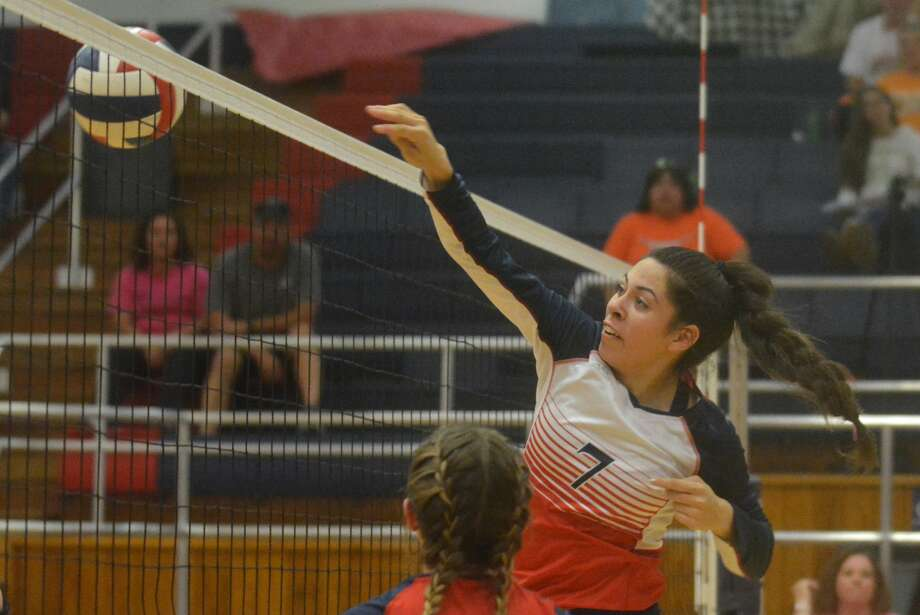 Plainview's Alexa Hinojos stuffs the ball back over the net for one of her six kills during a District 3-5A volleyball match against Caprock at the Plainview High School gym Tuesday night. Photo: Skip Leon/Plainview Herald