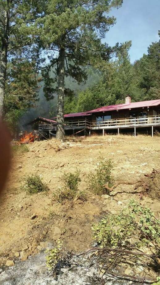 A New York state wildfire crew near Santa Rosa, Calif., helped save a home from further damage on Tuesday, Oct. 17, 2017. Photo: New York State Department Of Environmental Conservation