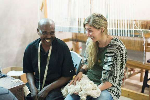 Imani Collective founder Jenny Nuccio discusses new product designs with director of weaving John Kirigo. The company recently revamped its entire product line to make it more appealing to general interest buyers.