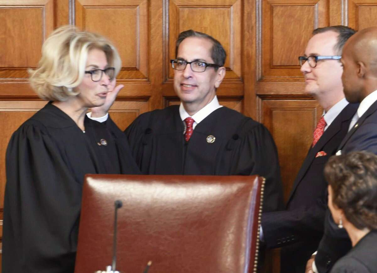 Chief Judge Janet DiFiore swears in Associate Judge Paul Feinman at the Court of Appeals on Wednesday.