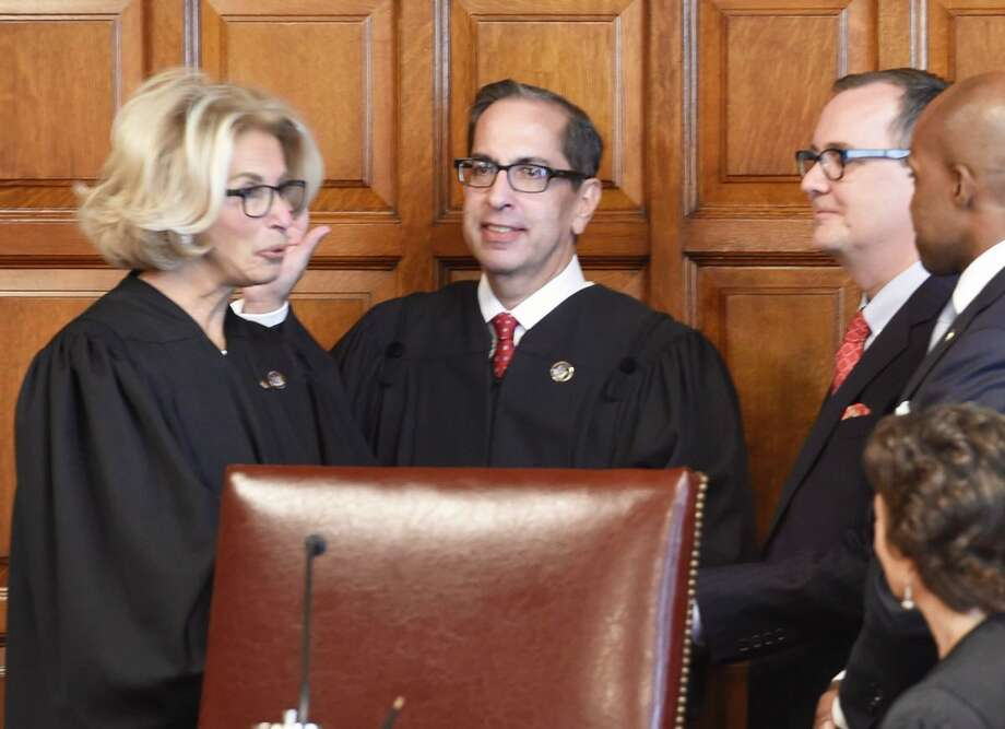 Chief Judge Janet DiFiore swears in Associate Judge Paul Feinman at the Court of Appeals on Wednesday. Photo: Skip Dickstein / Times Union