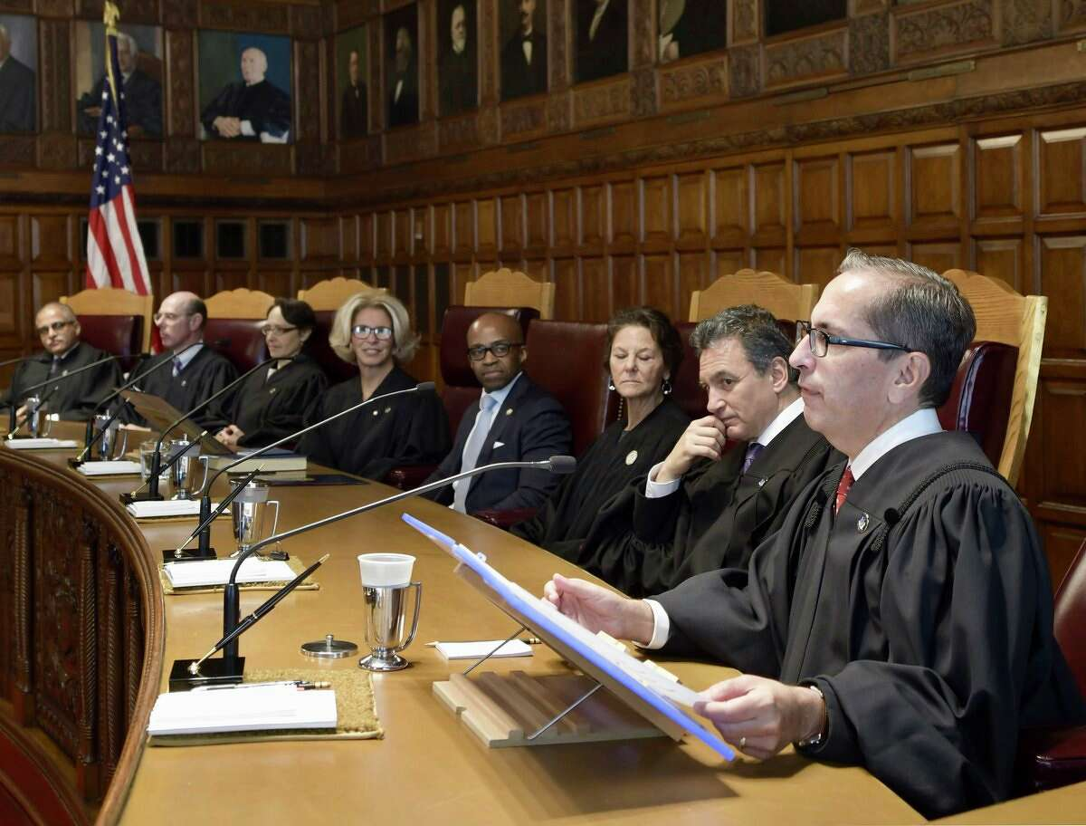 Associated Judge Paul Feinman, right, joins his colleagues on the state Court of Appeals on Wednesday.