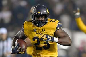 BERKELEY, CA - OCTOBER 13:  Vic Enwere #23 of the California Golden Bears carries the ball against the Washington State Cougars during the fourth quarter of their NCAA football game at California Memorial Stadium on October 13, 2017 in Berkeley, California.  (Photo by Thearon W. Henderson/Getty Images)