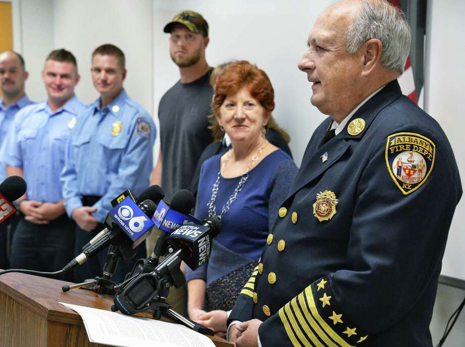 Mayor Kathy Sheehan and Fire Chief Warren W. Abriel, Jr., right, during a fire department news conference honoring firefighters and good samaritans from ast weekend's Yates Street fire Wednesday Oct. 18, 2017 in Albany, NY.  (John Carl D'Annibale / Times Union) Photo: John Carl D'Annibale, Albany Times Union / 20041869A