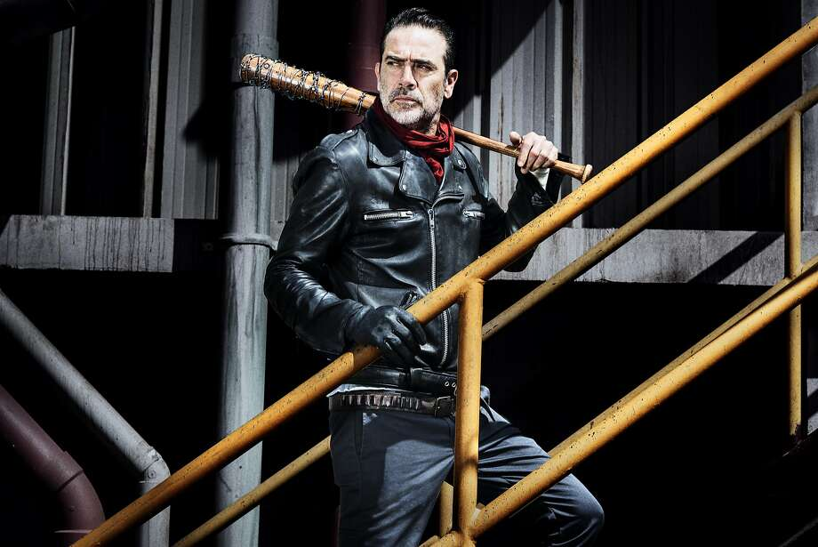 """The cruel demands of Negan (Jeffrey Dean Morgan) and his deadly spiked bat Lucille inspire an all-out war planned by Rick (Andrew Lincoln) and his group in the nail-biting season 8 opener of """"The Walking Dead"""" Sunday night. Photo: Courtesy Of AMC"""