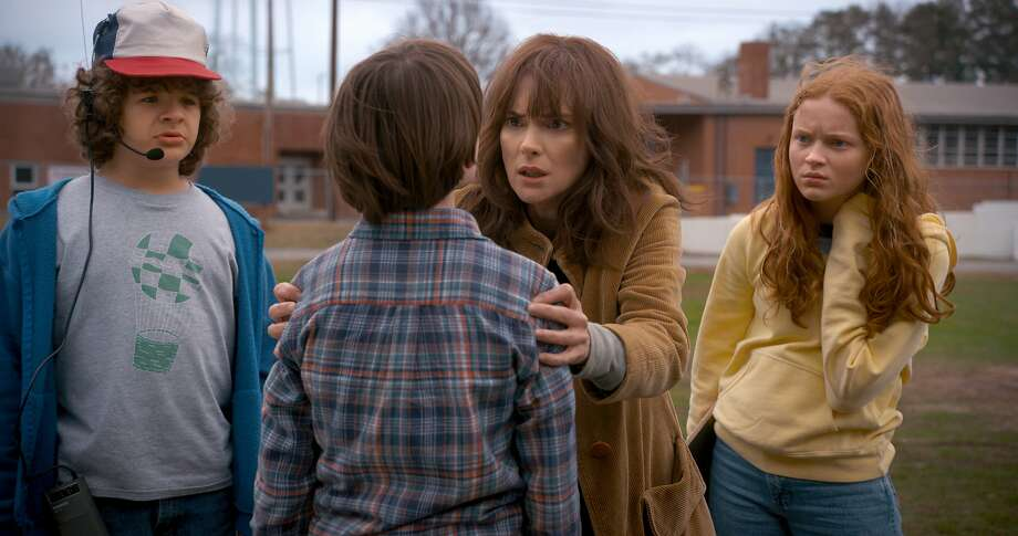 "Winona Ryder plays a freaked-out mom in ""Stranger Things,"" one of Netflix's hits. The Los Gatos company has committed to spending $18.6 billion on content — far more than rivals like Disney. Photo: Netflix"