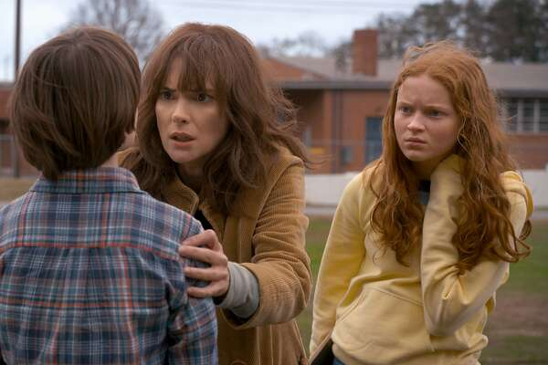 """The freaked-out mom and daring kids of Netflix's second round of horror hit """"Stranger Things."""" Pictured are Winona Ryder, Gaten Matarazzo, Noah Schnapp and a red-haired newcomer named Max (Sadie Sink)."""