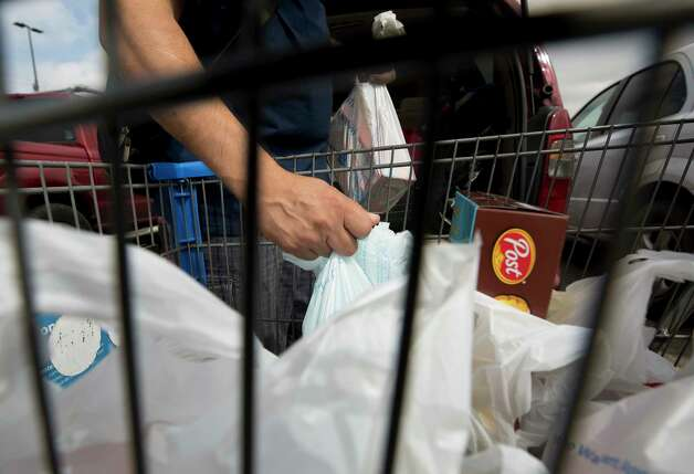 Pedro loads the trunk of his car with groceries Saturday, Oct. 7, 2017, in Houston. Pedro and his family have cut back on sending since president Donald Trump's inauguration, in case they have to return to Mexico or seek legal services. Photo: Godofredo A. Vasquez, Houston Chronicle / Godofredo A. Vasquez