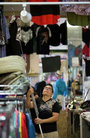 Emilia Alvarez hangs a t-shirt back for display inside E-Mily' Boutique Sunday, Oct. 1, 2017, in Houston. Photo: Godofredo A. Vasquez, Houston Chronicle / Godofredo A. Vasquez