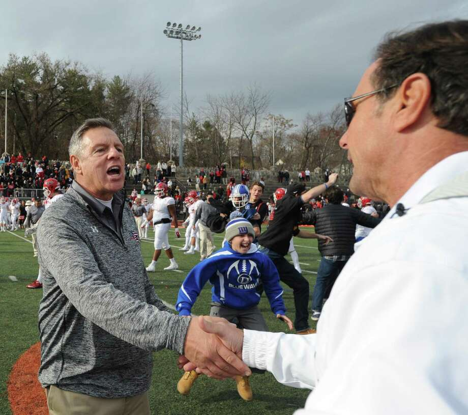 Lou Marinell, right, shakes hands with Rob Trifone. FCIAC Championship football game between New Canaan High School and Darien High School at Stamford High School's Boyle Stadium on Nov. 26, 2015. Darien took the championship Turkey Bowl title over New Canaan by a score of 28-21. Photo: Bob Luckey Jr. / Hearst Connecticut Media / Greenwich Time